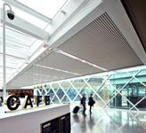 A linear aluminium ceiling system was installed internally and externally on the M&S link bridge