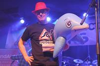 Construction Rocks Bill Price and an inflatable dolphin