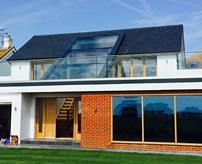 For this detached house in Worthing, Sussex, DVS supplied a bespoke PR60 glass roof with triangular glazed gables