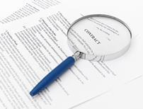 Magnifying glass on a contract