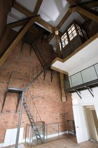 This clock tower, with its open-plan bathroom and wrought-iron stairs up to an original watchmaker's hut, is one of the most expensive apartments