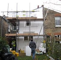 Insulation being fitted on Passivhaus refurbishment in Hackney